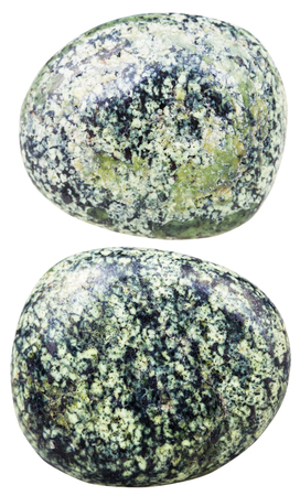 tumbled: macro shooting of natural mineral stone - two tumbled serpentine (Serpentinite) gemstones isolated on white background Stock Photo