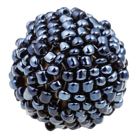 sewn up: beadwork - ball from many sewn black glass beads close up isolated on white background Stock Photo