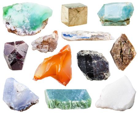topaz: collection of natural mineral crystal gemstones - nephrite, kyanite, garnet (almandine), pyrite, schorl (black tourmaline), topaz, zircon in rock, chalcedony, apatite, chrysoprase, sard, cacholong