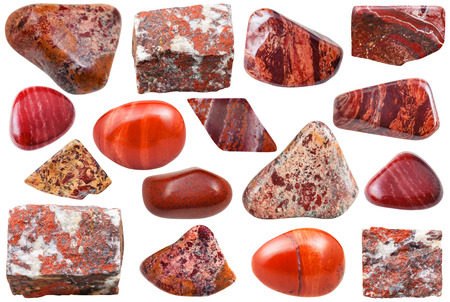 set of natural mineral stones - specimens of red jasper tumbled gemstones and rocks isolated on white background Standard-Bild