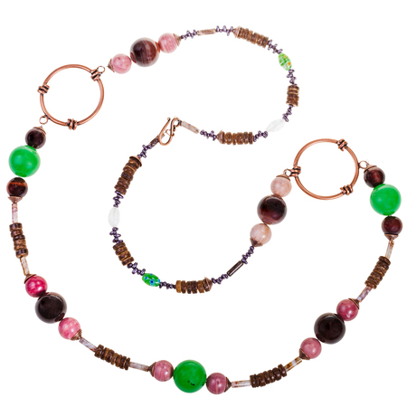 green gemstones: necklace from natural gemstones (green aventurine, tigereye, rhodonite, agate, jasper), carved coconut, glass beads, copper rings isolated on white background