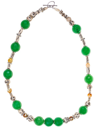 green gemstones: green necklace from natural gemstones (green aventurine, carved bone, yellow agate beads) isolated on white background