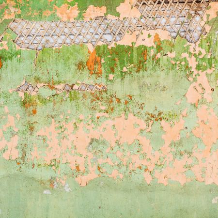 panelling: square background from peeling plaster and paint on wall of old wooden housel