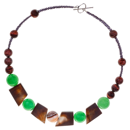 green gemstones: necklace from natural gemstones (green aventurine and brown agate), brown bone, glass beads isolated on white background