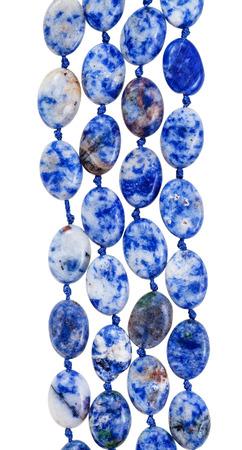 lapis: beads from blue lazurite gem stone isolated on white background Stock Photo