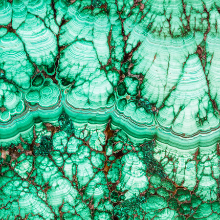 tumbled stones: square natural background - texture of malachite mineral gem stone close up Stock Photo