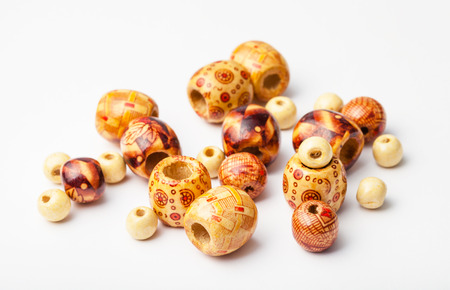 painted wood: set of painted natural wood beads close up Stock Photo