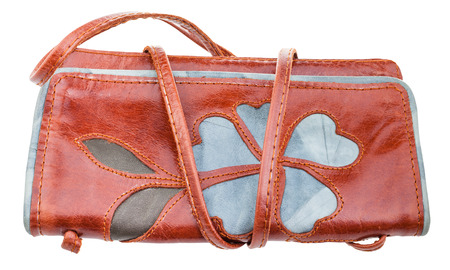 applique flower: little brown handbag decorated by flower applique isolated on white background