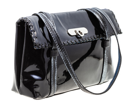 lacquered: ladies handbag from black lacquered leather isolated on white background Stock Photo