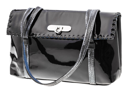 patent leather: female handbag from black patent leather isolated on white background