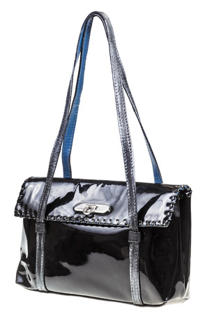 lacquered: evening bag from black lacquered leather isolated on white background