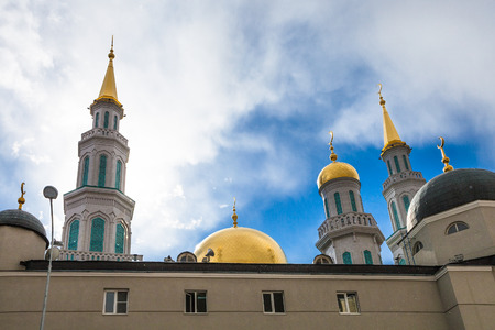 olimpiysky: towers of Moscow Cathedral Mosque in snowfall in sunny spring day