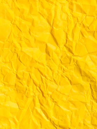 creasy: vertical background from yellow colour crumpled paper