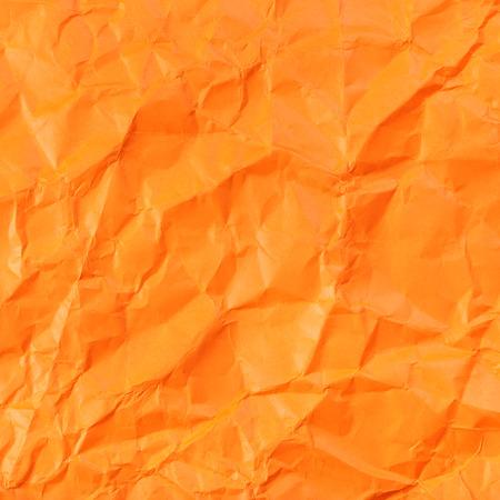 creasy: square background from orange colour crumpled paper Stock Photo
