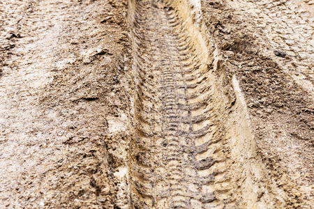 loamy: deep ruts of automobile wheels in loamy soil of country road in spring Stock Photo