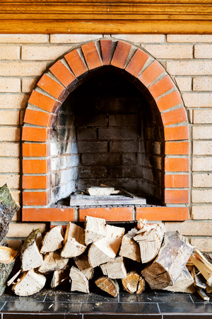 firebox: not kindled brick fireplace and wood logs indoor