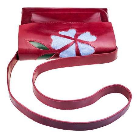 applique flower: dark cherry color handbag decorated by flower applique isolated on white background
