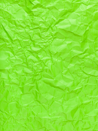 creasy: vertical background from green colour crumpled paper