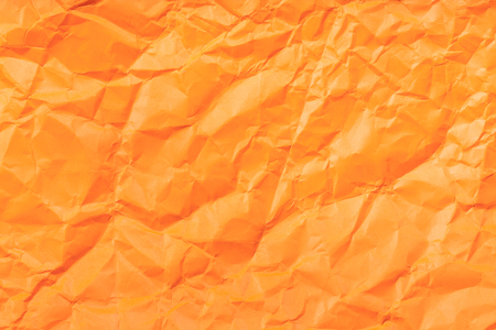 creasy: background from orange colour crumpled paper