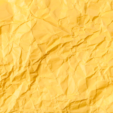 creasy: square background from yellow colour crumpled paper Stock Photo