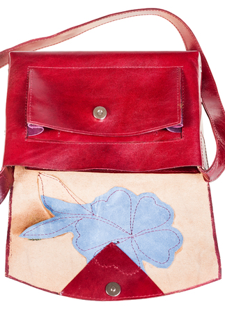 applique flower: open dark cherry color handbag decorated by flower applique isolated on white background