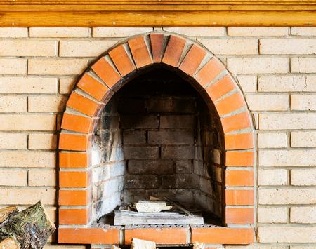 firebox: fire-box of not kindled brick fireplace indoor