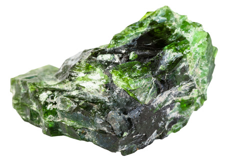 emerald stone: macro shooting of natural mineral stone - raw chrome diopside (green diopside, Siberian emerald) stone isolated on white background