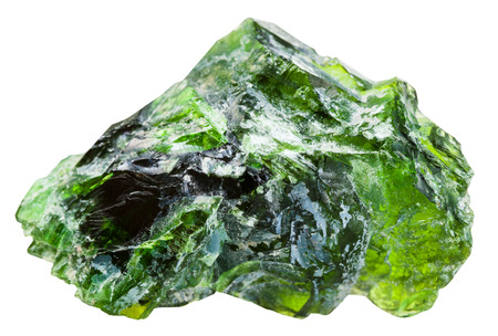 green gemstone: macro shooting of natural mineral stone - raw chrome diopside (green diopside, Siberian emerald) gemstone isolated on white background