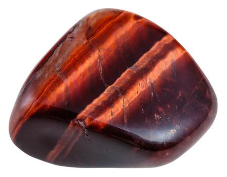gemmology: macro shooting of natural mineral stone - polished red bulls eye gemstone isolated on white background