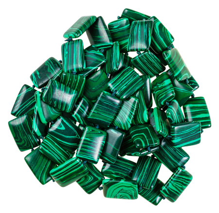 green gemstones: string of beads from mineral gemstones - green artificial malachite stones isolated on white background
