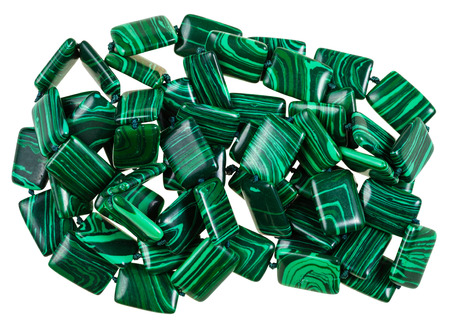green gemstones: necklace from mineral gemstones - green artificial malachite stones isolated on white background