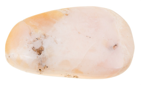 gemmology: macro shooting of natural mineral stone - polished pink opal gemstone from Peru isolated on white background