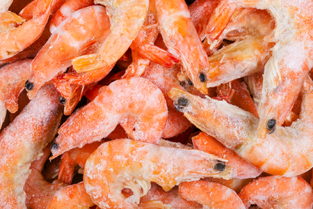 close up food: food background - many frozen boiled shrimps close up