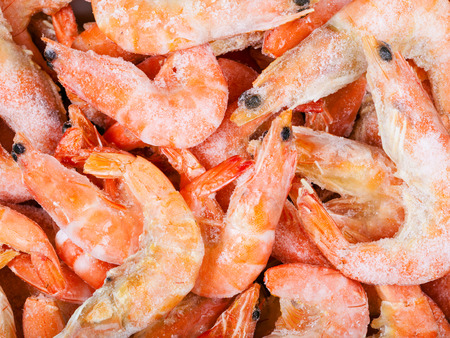 close up food: food background - many frozen boiled red shrimps close up
