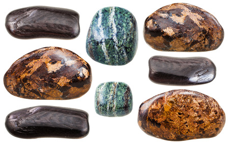 green gemstones: set of various Enstatite (bronzite, green and brown hypersthene) natural mineral stones and gemstones isolated on white background