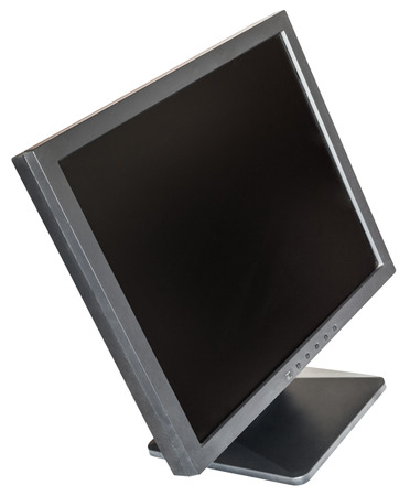 cut out device: side above view of old used black LCD monitor isolated on white background