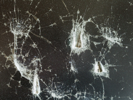 blows: trace of blows on damaged potective glass of LCD monitor close up Stock Photo