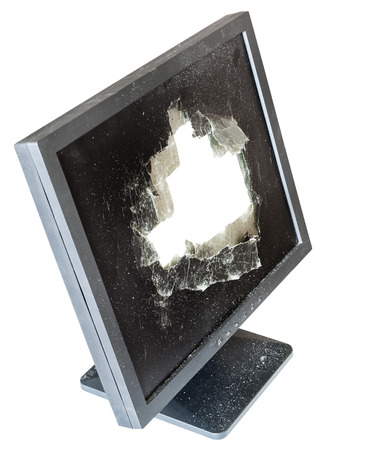 snapped: side above view of broken monitor with cut out damaged glass screen isolated on whit Stock Photo