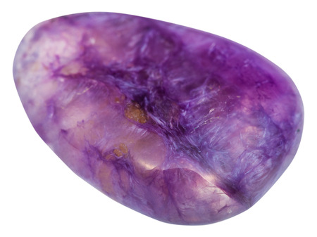 tumbled: macro shooting of natural mineral stone - tumbled cabochon of charoite gemstone isolated on white background