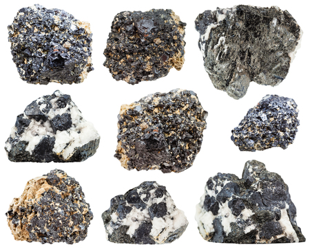 set of various natural mineral stones - Perovskite and knopite crystals (titanium ore, calcium titanate) isolated on white background