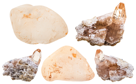 set of natural topaz crystals on rock and polished gem stones isolated on white background