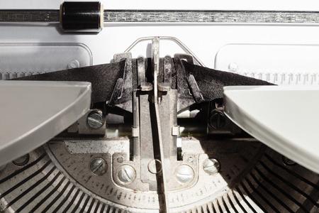typebar: typebar types ink ribbon in old typewriter close up
