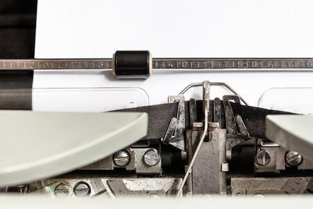 typebar: typebar types ink ribbon in mechanical typewriter close up Stock Photo