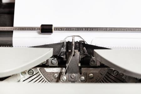 typebar: typebar hits ink ribbon in mechanical typewriter close up Stock Photo