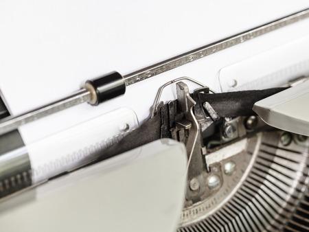 typebar: side view of typebar types ink ribbon in old typewriter