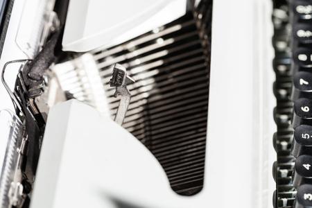 typebar: side view of typebar operates in mechanical typewriter