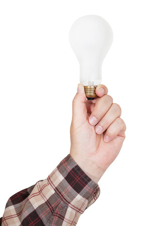 e27: male hand holds incandescent lamp isolated on white background Stock Photo
