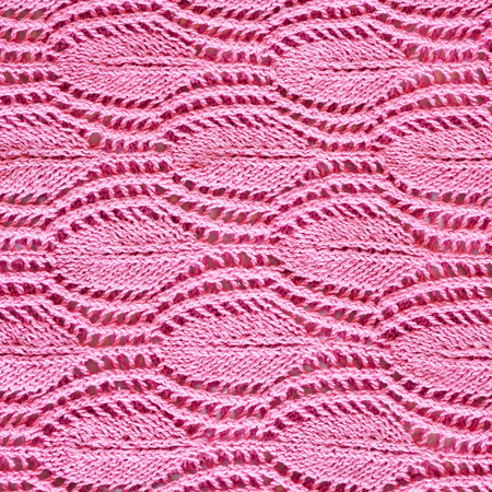cotton thread: hand-knitted pink pattern close up knitted with cotton thread Stock Photo