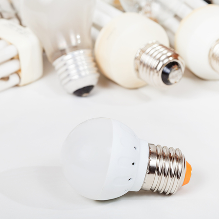 e27: one new LED lamp and several old incandescent light bulbs and used compact Fluorescent lamps