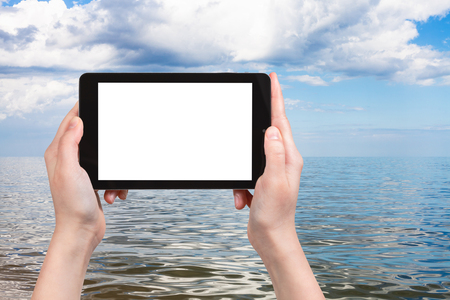 travel concept - tourist photographs of Azov Sea on tablet pc with cut out screen with blank place for advertising Stock Photo